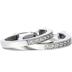Silver jewelry creates an elegant retro look with silver hoop earrings